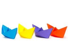 四艘色纸船 免版税库存照片