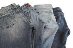 四件牛仔裤。 免版税库存图片