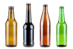 四differen在白色隔绝的啤酒瓶 免版税库存照片