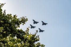 四Eurofighter喷气机飞行用西班牙语国庆节游行 免版税库存照片