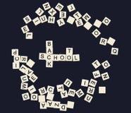 回到信函塑料学校拼写瓦片 免版税库存图片