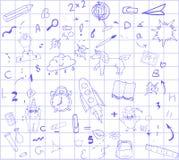 回到在白色背景的学校蓝色笔在一只蓝色四联体的笼子,教育,广告的概念横幅的 免版税图库摄影