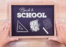 回到在黑板的学校课文有白垩和文具的 图库摄影