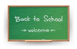 回到学校。在白垩写了在黑板 免版税库存照片