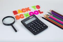 回到学校信件,计算器和固定式 免版税库存图片