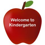 回到学校欢迎到幼儿园红色苹果 免版税库存照片