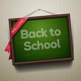 回到学校,写在有白垩的黑板 免版税库存图片