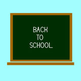 回到学校,写在有白垩的黑板 图库摄影
