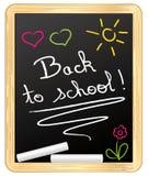 回到学校!用粉笔写在学校板岩 库存图片