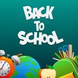 回到有闹钟地球背包的学校 免版税库存照片
