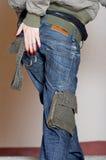 回到牛仔裤妇女 免版税库存图片