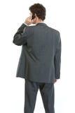 回到生意人移动电话告诉的突出 图库摄影