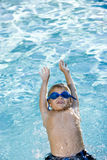 回到男孩他的池游泳 库存照片