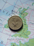 回到硬币一镑 免版税库存照片