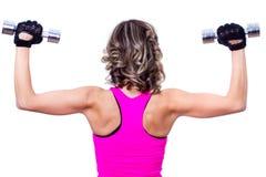 回到美丽的执行的执行健身妇女年轻人 库存照片