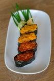 回到背景筷子寿司 库存照片
