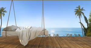 回报在大阳台在海滩附近和海的美丽的垂悬的床有好的天空视图和棕榈树的3d在夏威夷在暑假 库存照片