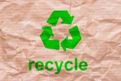 回收在包装纸的标志 免版税库存照片