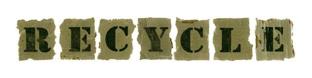 回收在被回收的纸的文本 免版税库存照片