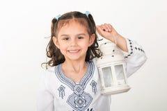 回教女孩在赖买丹月 免版税库存照片