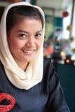 回教微笑的妇女 免版税库存照片