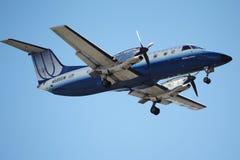 团结的快速(SkyWest)巴西航空工业公司EMB-120 免版税图库摄影