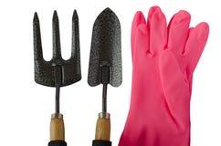 园艺工具和手套在白色背景 免版税图库摄影
