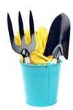 园艺工具和蓝色桶 免版税库存图片