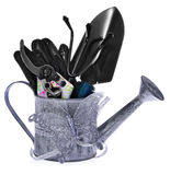 园艺工具的构成:银色喷壶,色的剪 图库摄影