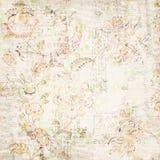 困厄的古色古香的花卉和文本墙纸 免版税库存照片