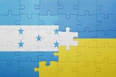 困惑与乌克兰和洪都拉斯的国旗 库存照片