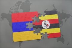困惑与亚美尼亚和乌干达的国旗世界地图的 免版税图库摄影
