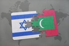 困惑与以色列和马尔代夫的国旗世界地图背景的 免版税库存图片