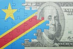 困惑与刚果民主共和国和美元钞票国旗  库存图片