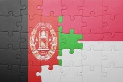 困惑与印度尼西亚和阿富汗的国旗 库存图片