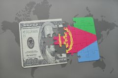 困惑与厄立特里亚和美元钞票国旗在世界地图背景 图库摄影