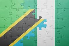 困惑与坦桑尼亚和尼日利亚的国旗 库存图片