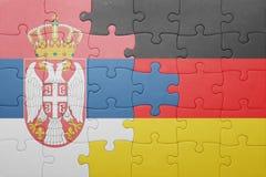 困惑与塞尔维亚和德国的国旗 库存图片