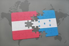 困惑与奥地利和洪都拉斯的国旗世界地图背景的 库存照片