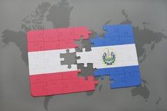 困惑与奥地利和萨尔瓦多的国旗世界地图背景的 库存图片