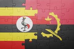 困惑与安哥拉和乌干达的国旗 图库摄影