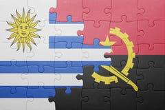 困惑与安哥拉和乌拉圭的国旗 免版税库存图片