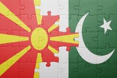 困惑与巴基斯坦和马其顿的国旗 库存照片