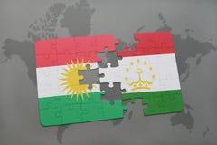 困惑与库尔德斯坦和塔吉克斯坦国旗在世界地图背景 免版税库存图片