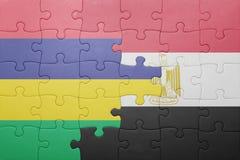 困惑与毛里求斯和埃及的国旗 库存图片