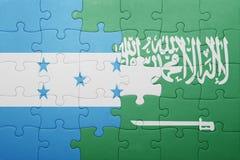 困惑与沙特阿拉伯和洪都拉斯的国旗 免版税库存照片
