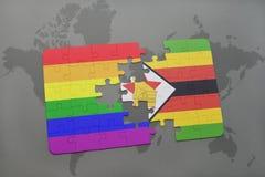 困惑与津巴布韦的国旗和在世界地图背景的快乐彩虹旗子 免版税库存照片