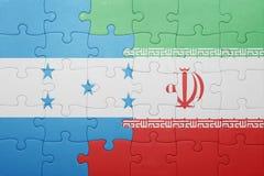 困惑与洪都拉斯和伊朗的国旗 库存图片