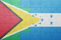 困惑与洪都拉斯和圭亚那的国旗 免版税图库摄影