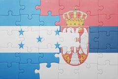 困惑与洪都拉斯和塞尔维亚的国旗 概念 库存图片